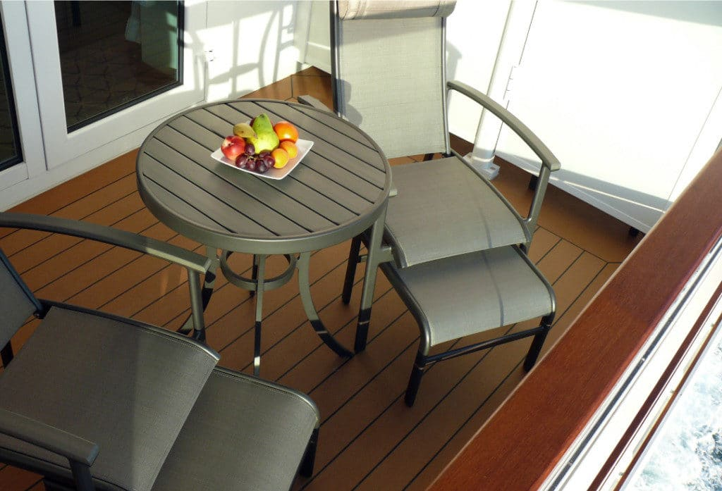 The spacious veranda with reclining deck chairs.