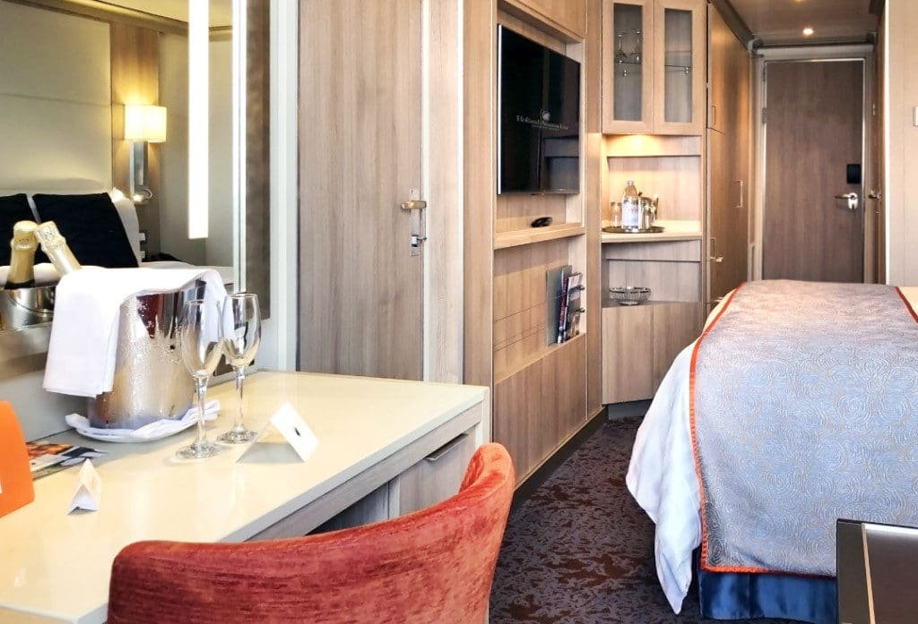 The Verandah Stateroom has a writing desk and wall mounted TV.