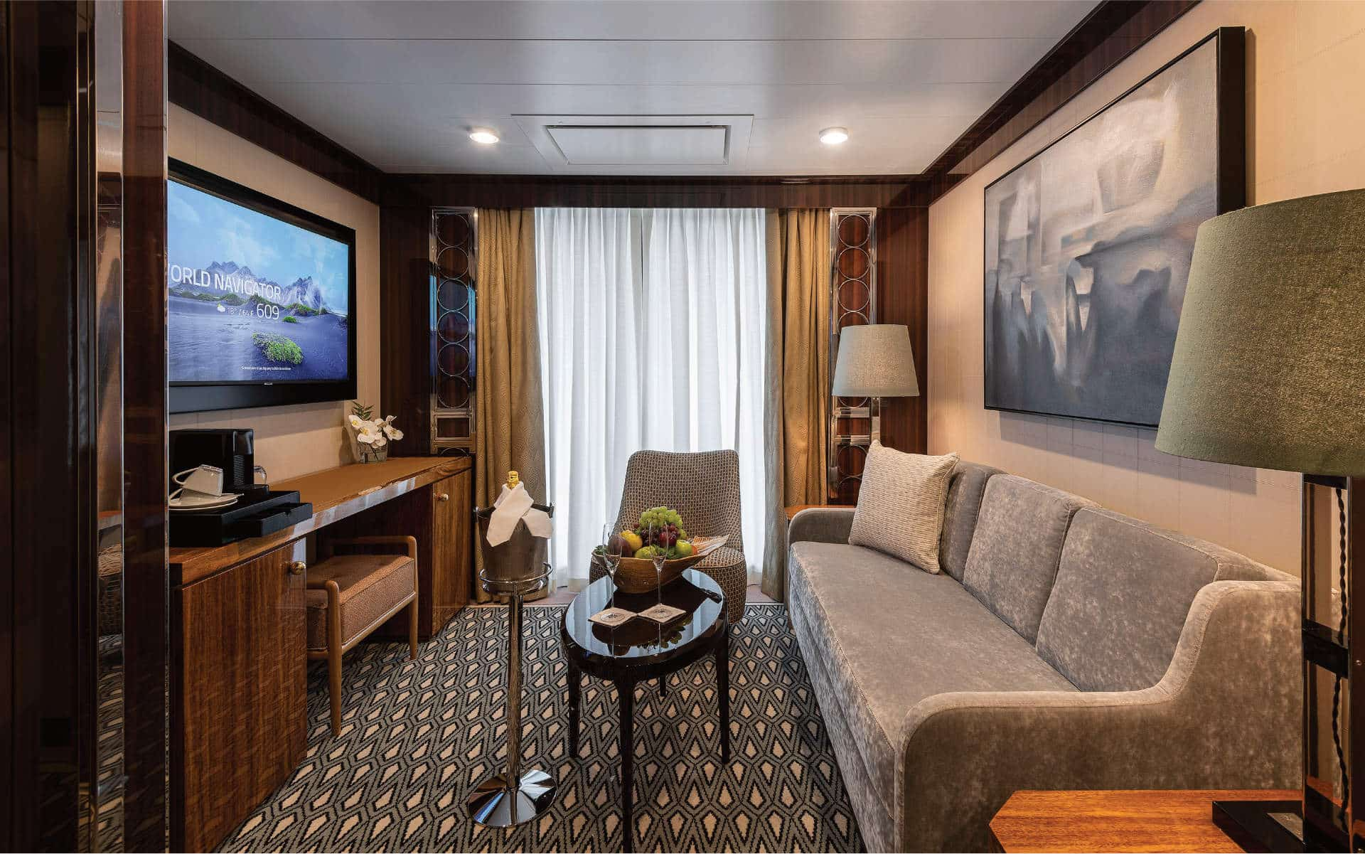The comfortable living room in the Horizon Suite on World Navigator.